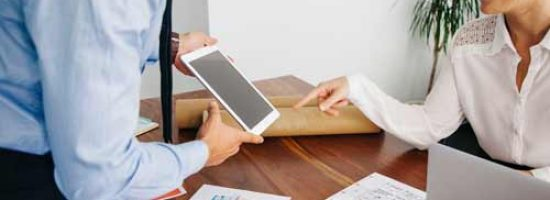 real-estate-business-people-with-tablet-opt